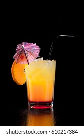Alcoholic cocktails on a black background, in a tall glass