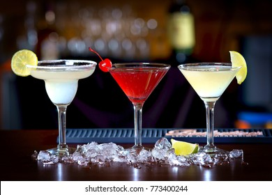 alcoholic cocktails on a dark background
