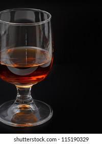 Alcoholic drink close up, black background