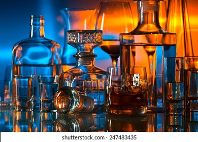 alcoholic drinks in bar on glass table