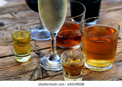 alcoholic drinks at the wooden table.