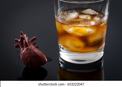 Alcoholic heart failure and damage or cardiomyopathy concept with a heart next to a glass of alcohol. Cardiomyopathy is a group of diseases that affect the heart muscle