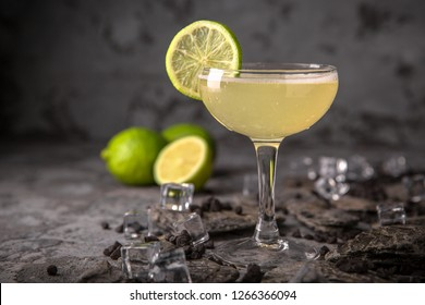 Alcoholic or non-alcoholic cocktail with lime citrus with the addition of liquor, vodka, champagne or martini. Cool drink. Easy Bartenders Recipes and Ideas