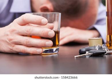 Alcoholic sleeping on the table with car keys