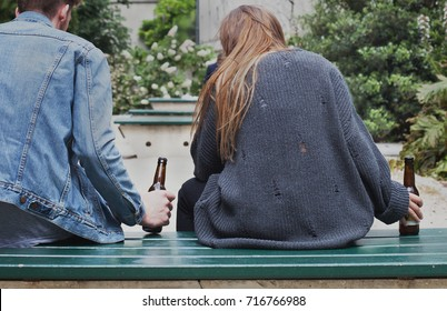 alcoholism concept, young people drinking beer on the street