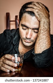 Alcoholism : Portrait of a lonely and desperate drunk hispanic man
