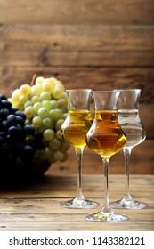 alcoolic drink grape distillate in glass rustic background