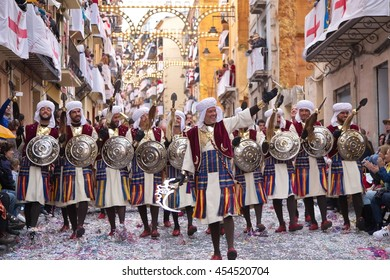 Alcoy, Spain - April 22, 2016: People dressed as Moors legion marching in annual Moros y Cristianos parade in Alcoy, Spain on April 22, 2016