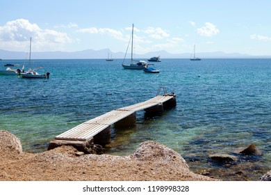 ALCUDIA, MAJORCA, SPAIN - September 24rd, 2018: Boats docks on Aucanada beach near popular tourist resort of Port d'Alcudia