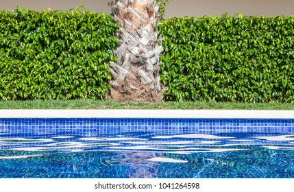 Alcudia, Mallorca, Balearic Islands, Spain, September 26 2015.  Abstract patterns of light and reflections on a swimming pool.