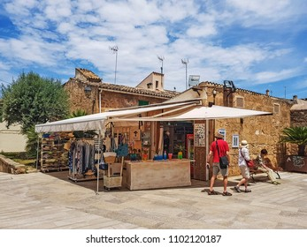 ALCUDIA, MALLORCA - MAY 23, 2018:  A stall in front of the Church of Saint James of Alcudia.It is the main tourist centre in the North of Majorca on the eastern coast