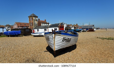 ALDEBURGH, SUFFOLK, ENGLAND - MAY 05, 2018: Aldeburgh beach with boats and old Lifeboat station with tower.