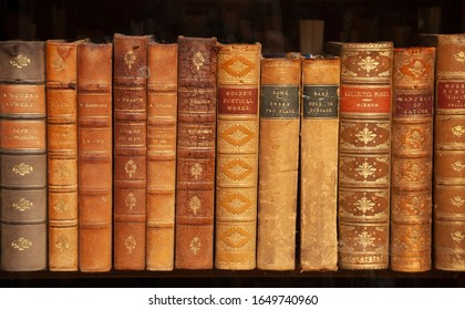 Aldeburgh, Suffolk. UK. May 30th 2012. A row of dusty and worn books in a bookshop window.