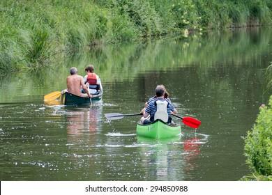 ALDERMASTON, BERKSHIRE UK - JULY 5 : Canoeing on the Kennet and Avon Canal near Aldermaston Berkshire on July 5, 2015. Unidentified people.