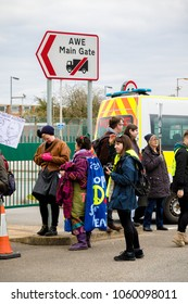 Aldermaston, United Kingdom, 1st April 2018:- CND protesters gather outside the main gate to the AWE where Britain's nuclear warheads are made, on the 60th anniversary of the first CND march in 1958