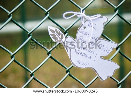 Aldermaston, United Kingdom, 1st April 2018:- Messages left on the fence outside the main gate to the AWE, on the 60th anniversary of the first CND march in 1958