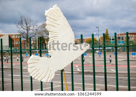 Aldermaston, United Kingdom, 1st April 2018:- A paper dove of peace outside the main gate to the AWE where Britains nuclear warheads are made, on the 60th anniversary of the first CND march in 1958