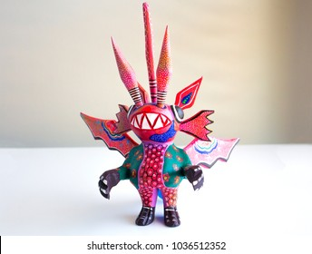 Alebrije monster figure on white surface