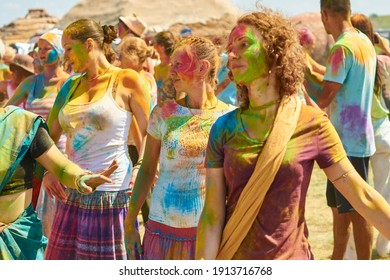aleksandrovsky, russia 2015.06.21 a crowd of Hare Krishna people having fun and dancing at the festival of colors holi
