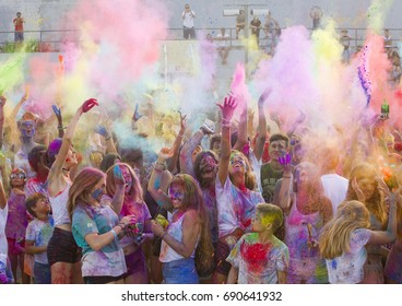 ALELLA, SPAIN - JULY 31: Some unidentified young people at Holi Festival, on July 31, 2017, in Alella, Barcelona, Spain.