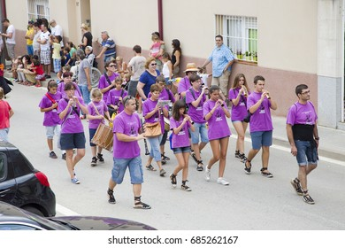 ALELLA, SPAIN - SEPTEMBER  14: People at La Verema Wine Festival, a traditional party of Alella, with a traditional parade of Giants and Big Heads, on September 14, 2014 in Alella, Barcelona, Spain.