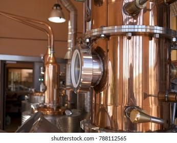 alembic still for making alcohol inside distillery, destilling spirits