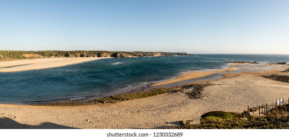ALENTEJO, PORTUGAL - JULY 26, 2015: The beach at Vila Nova de Milfontes looking over the mouth of the Mira River towards Furnas Beach, also known as Praia das Furnas, in Portugal