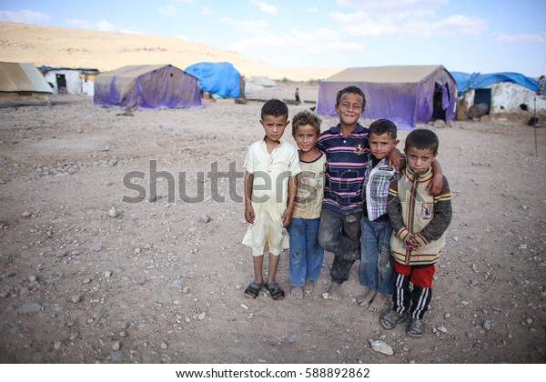 Aleppo, Syria - December 2016: A children at Refugee camp near the village outside Aleppo city in Syria