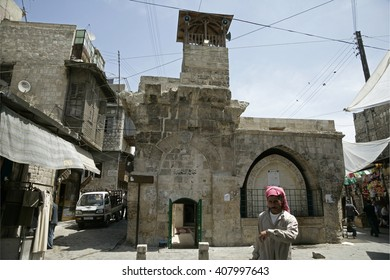 ALEPPO, SYRIA - May 2009. Unidentified people in the old Aleppo. Medieval fortified palace in the old city of Aleppo in Syria on May 2009. UNESCO World Heritage Site since 1986.