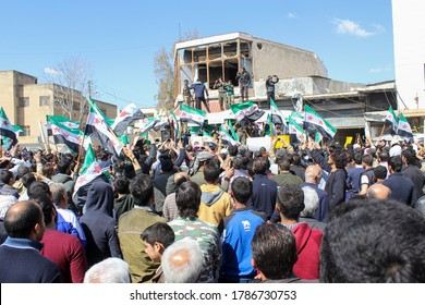 Aleppo, Syria October 18, 2018 A demonstration bearing the flags of the Syrian revolution calls for an end to the bombing of Idlib.