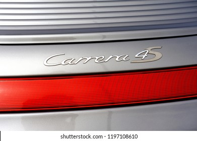 ALES, FRANCE – SEPTEMBER 9, 2018: back detail on the Carrera 4s logo of a sports car Gray porche on a parking lot of the city of Ales in the Gard department