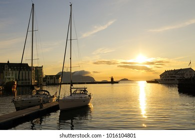 Alesund, Norway - August 10, 2010: Beautiful view at sunset in the port of Alesund with yachts.