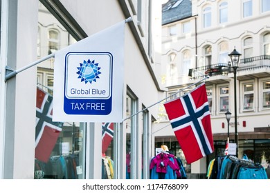 Alesund, Norway, July 27, 2018: Global Blue tax free shopping is advertised on a flag at a souvenir store.
