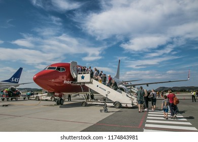 Alesund, Norway, July 28, 2018: Passengers are boarding a Norwegian plane scheduled to fly to Oslo, Norway.