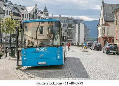 Alesund, Norway, July 28, 2018: City bus is taking on passengers on one of its stops.