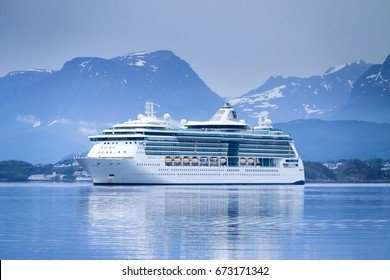 ALESUND, NORWAY - June 10, 2017: SERENADE OF THE SEAS inbound Alesund. SERENADE OF THE SEAS is a Radiance class cruise ship that is owned and operated by Royal Caribbean International cruise line.
