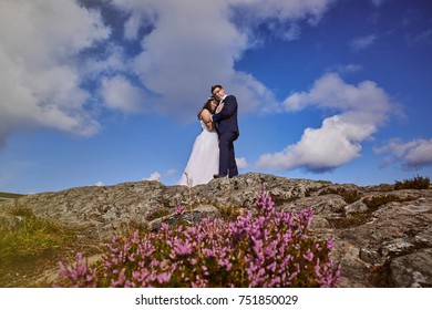 Alesund, Norway - June 11, 2017: Wedding photo session in Alesund, Norway. Two happy people standing on Aksla hill.