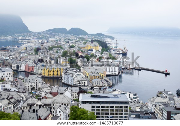 Alesund, Norway - May 24, 2018: Aerial view of Alesund cityscape and surroundings. Alesund is port town on the west coast of Norway. View from the mountain Aksla at the city of Alesund, Norway