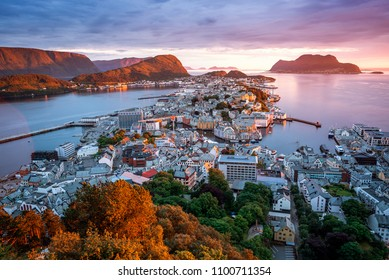 Alesund is a port and tourist city in Norway. Famous tourist attraction. View point on Mount Aksla. Beautiful sunset