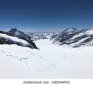 The Aletsch glacier. Europe's largest glacier. Offering a spectacular view of crevices snow capped Swiss Alps and the ice field supplying this majestic glacier.