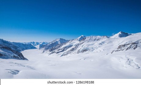 The Aletsch glacier, seen from the Jungfraujoch, is Europe's largest glacier. Landscape of Snowy Mountain of Swiss Alps. Gigantic Mountain of Switzerland. Scenic View of Mountain Landscape.