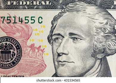 """Alexander Hamilton"" face on US ten or 10 dollars bill macro, united states money closeup"
