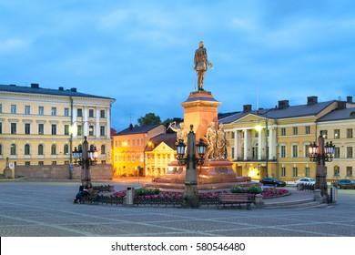 Alexander II monument on Senate square with Helsinki university, Finland