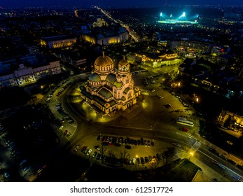 Alexander Nevsky Cathedral, Sofia, Bulgaria at Night. Parliament, university, soccer game in the background.