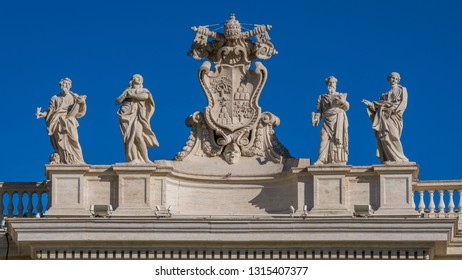 Alexander VII coat of arms and saints statues (Mark, Mary, Ephraim and Theodosia) in the colonnade of Saint Peter Basilica in Rome, Italy.