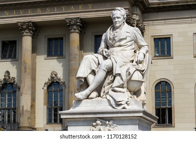Alexander von Humboldt statue outside Humboldt University from 1883 by Reinhold Begas, Berlin, Germany, sunny day
