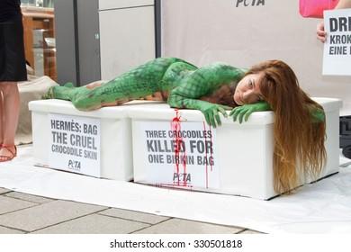 Alexandra Kamp with bodypainting by artist Hartmut-Matthias Graf von Matuschka attending a Peta protest in front of Hermes store, Neuer Wall, Hamburg, Germany, 26.08.2015.