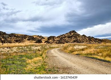 Alexandra, New Zealand - December 29 2019: Otago Central Rail Trail Rocky Hill Landscape - Shutterstock ID 1613745439