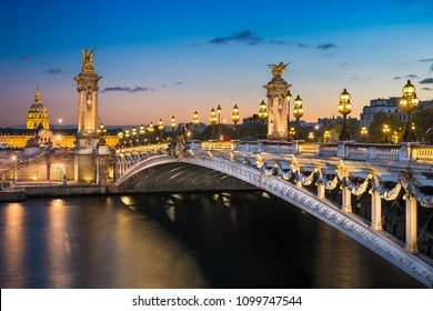 Alexandre III bridge at night in Paris, France