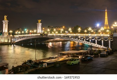 Alexandre III bridge at night in Paris, France. It is one of the main travel attractions of Paris. Panoramic view of Paris at night.